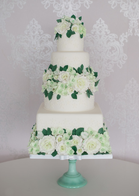 Wedding cake with pastel green flowers