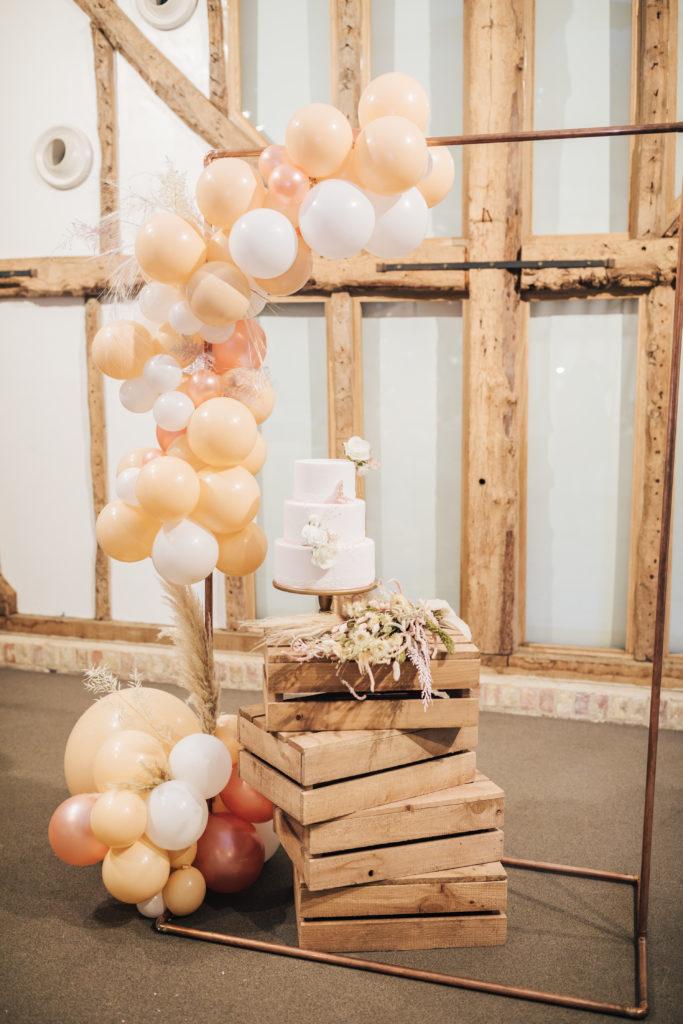 Natural barn weddings - balloon arch