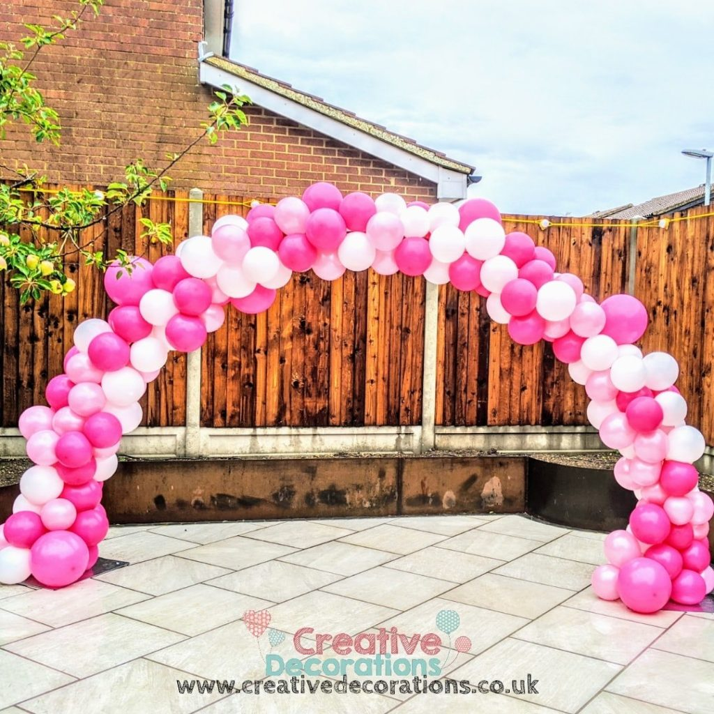 Pink and white balloon arch for garden parties
