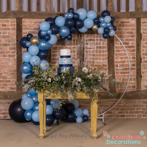 Blue wedding balloon hoop decor