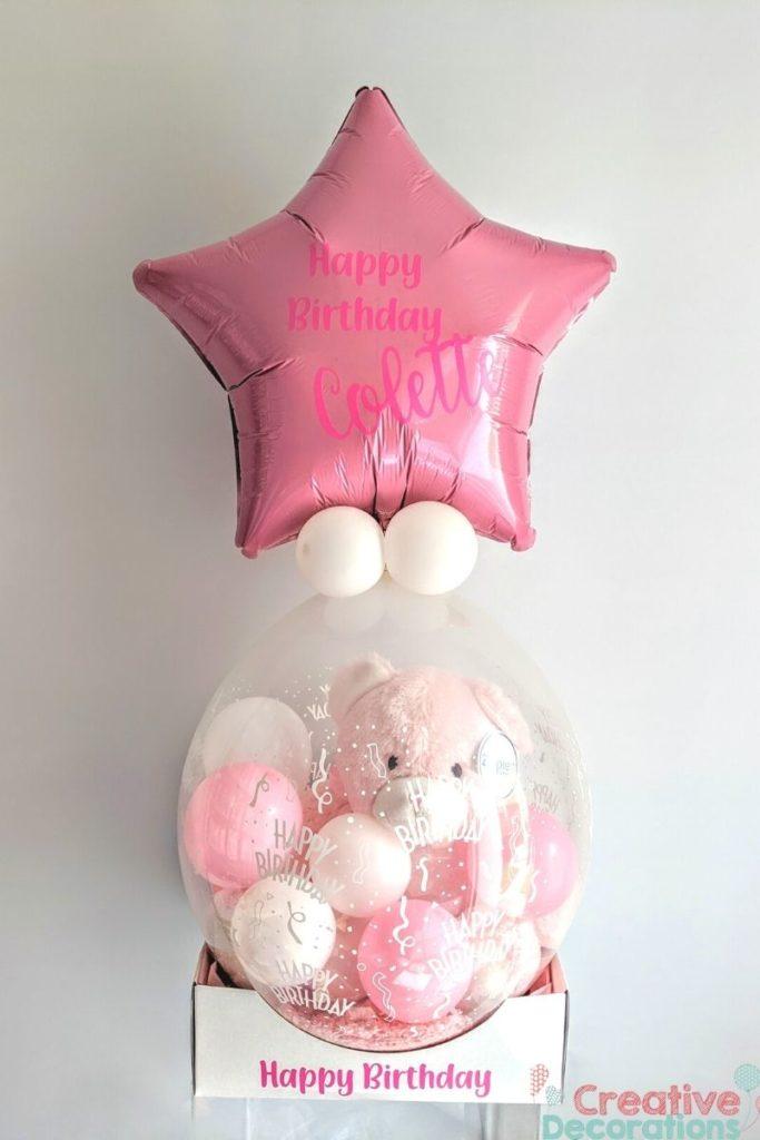Pink Teddy in a stuffed balloon