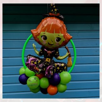 Balloon hoop with sitting witch